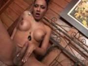 Big breasted brunette tranny Alana masturbating her huge prick